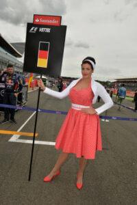 formula 1 girl holding sebastian vettel flag at british GP