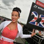 formula 1 gird girl holding jenson button team flag
