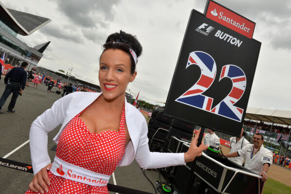 formula 1 gird girl holding jenson button team flag